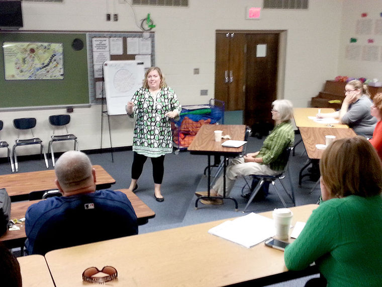 "Kimberly Robertson of Goodwill of the Southern Alleghenies leads the first in a monthly series of ""Coffee Talk"" sessions at Greater Johnstown Career & Technology Center that will focus on the challenge of poverty."