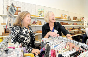 Wendi Copeland of Goodwill Industries International (left) and Phyllis Bandstra, president and CEO of Goodwill of the Southern Alleghenies, tour the local agency's store in Richland Township on Thursday.