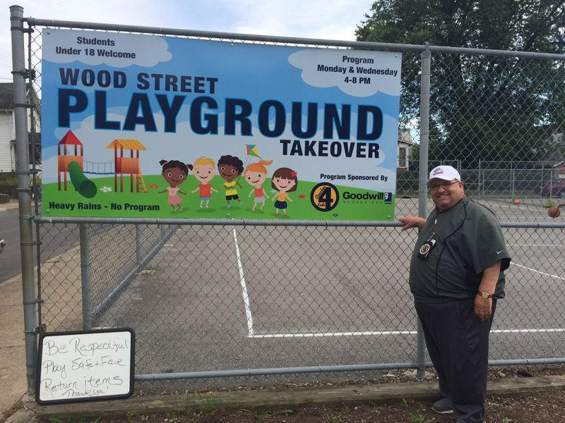 "Submitted photo: Tony Penna, Sr. of Ferndale stands next to a sign promoting the ""Wood Street Playground Takeover"" summer activity program for kids, sponsored by the Coaches 4 Kids Foundation and Goodwill Industries' GoodGuides Youth Mentoring Program. The ""Playground Takeover"" is one of at least five projects Penna is working on through his foundation to benefit children in Cambria and Somerset counties."