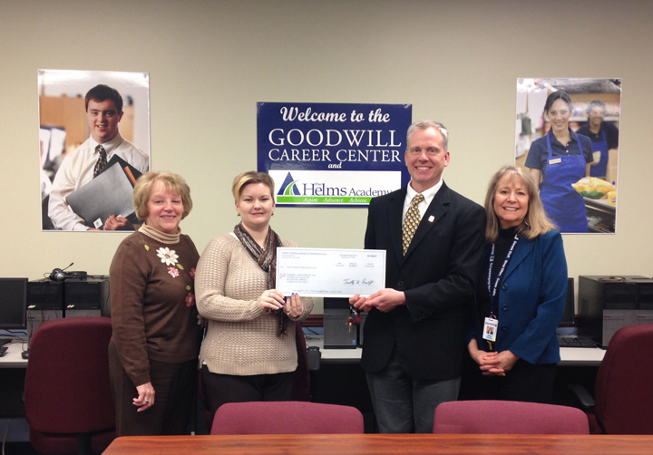 Mary Lou Gelles, FNB's Moxham Branch Manager; Krystal L. Hunter, FNB's Downtown Branch Manager; Bradley R, Burger, Goodwill's President/CEO; and Ann Torledsky, Goodwill's Vice-President of Workforce Development.