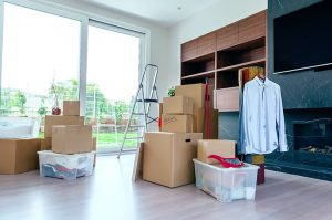 Large living room with stack of moving boxes